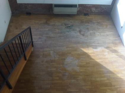 Prefinished floors with heavy damage from paint and paint thinner