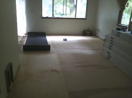 Subflooring and vapor barrier installation